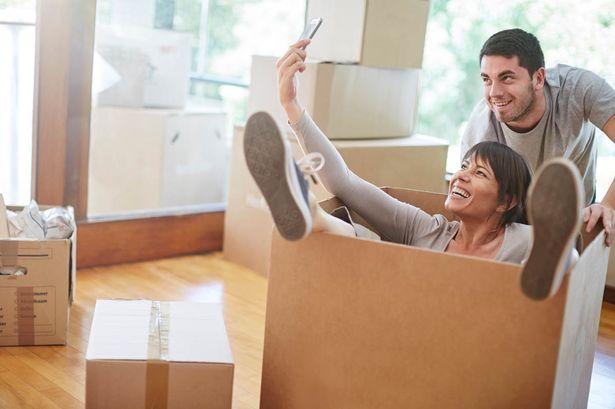 playful-couple-moving-house
